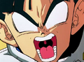 Frieza punchs gohan in the stomach