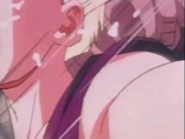 Turles hits gohan in the neck mkaeing the boy cough up spit e