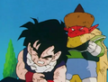 Gohan holding his arms aruond his stomach
