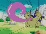 Giran lanzando los anillos de goma a goku