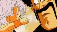Trunks derrotando a satán