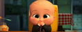 Food coming out of Boss Baby's mouth while he is laughing
