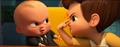 Tim and Boss Baby looking angry at each other