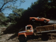 """General Lee jumping over an eighteen wheeler in episode """"A Little Game of Pool"""""""