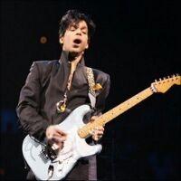 Musicology tour prince jamming on blue guitar.jpg