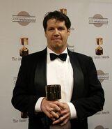 Guy Moon with a Annie Award