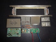 Disassembled S-Series call station parts