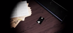 The black keycard required to open the extras.png