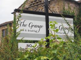 The Grange sign.png