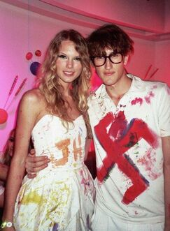 Taylor posing with a guest sporting a swastika tshirt