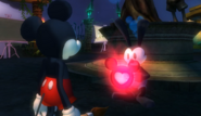 Oswald giving Mickey a Health Upgrade