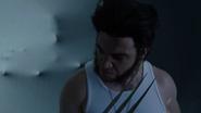 Freddy Krueger emerges behind of Wolverine