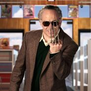 Stan Lee with claw