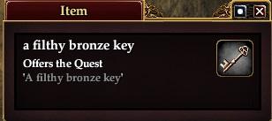 A filthy bronze key (Item)
