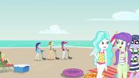 Rarity, AJ, and Rainbow searching the beach EGDS15