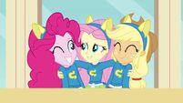 Fluttershy hugging Pinkie and Applejack