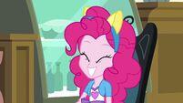 Pinkie Pie smiling with fake pony ears