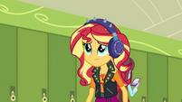 Sunset wearing noise-cancelling headphones EGDS5