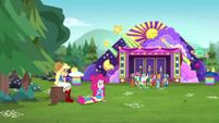 Applejack and Pinkie outside the concert CYOE15b