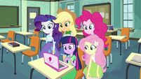 Twilight and friends in front of a laptop