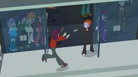 Students running into the school EG