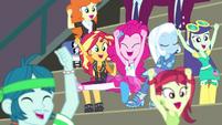 Sunset and Pinkie cheering next to Trixie CYOE17b