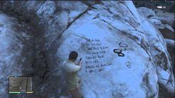 Mensaje escrito por Merle Abrahams en una roca