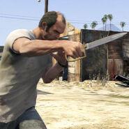 Trevor con un puñal