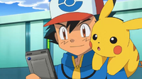 EP702 Ash usando la pokedex