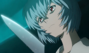 Rei looking at a knife (Rebuild)