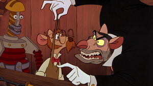 Professor Ratigan threatens Hiram Flaversham