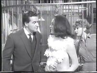 The defeated captive receptionist (Yolande Turner with Patrick Macnee and Diana Rigg)