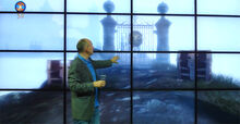 Peter Molyneux showing the Gate of the Road to Rule