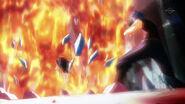 Natsu attacks the tower