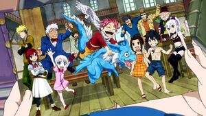 Lucy holding a picture of the young Fairy Tail Mages.jpg