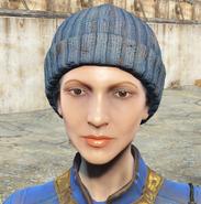 Gray knit cap worn