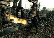 Enclave troop burning Ghouls National Guard depot