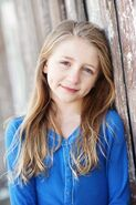 Emma Rayne Lyle as young anna