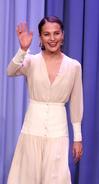 Alicia Vikander waving