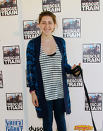 Eden Sher Wearing a Blue Jacket and a Soop Neck Stripe Shirt