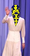Alicia Vikander waving in her mask