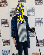 Eden sher wearing a head mask over her head