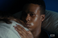 Matt, holding Alicia, calls Madison with a look
