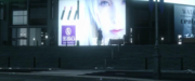 Billboard with a woman in Kingsglaive FFXV.png