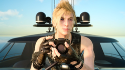 Prompto taking a photo on the royal vessel in FFXV