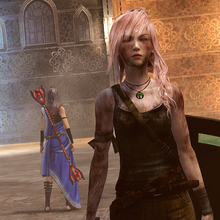 LRFFXIII Lara Croft TOMB RAIDER Gear 's Victory Pose.png