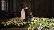 Cloud awakes in Aerith's flower bed.