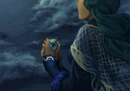 Almedha holding a stone
