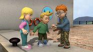 Norman shows Sarah & James his ammonite
