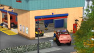 Sam parks Hydrus into the Fire station bay